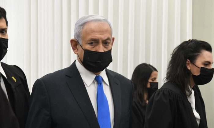 Israeli Prime Minister Benjamin Netanyahu stands at a hearing at the district court in Jerusalem on Feb. 8, 2021. (Reuven Castro/AP Photo)