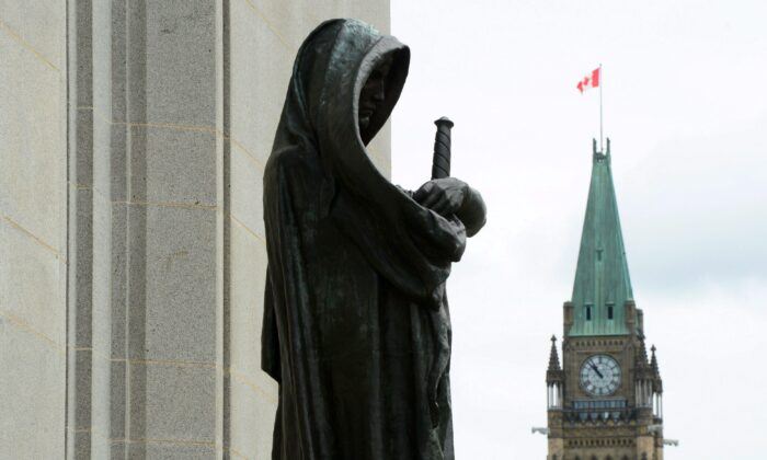 The Peace Tower on Parliament Hill is seen behind the justice statue at the Supreme Court of Canada, which could be asked to rule on the constitutionality of Bill C-7. To level the playing field for end-of-life options, palliative care should be made available to all Canadians. (Sean Kilpatrick/The Canadian Press)