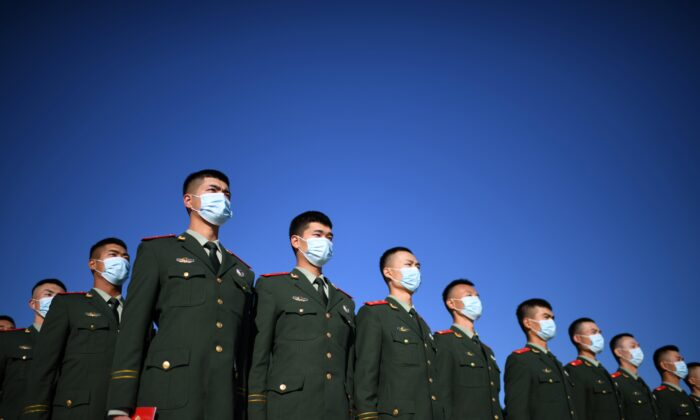 Chinese paramilitary police officers gather at Tiananmen Square in Beijing, China on Oct. 23, 2020. (NOEL CELIS/AFP via Getty Images)