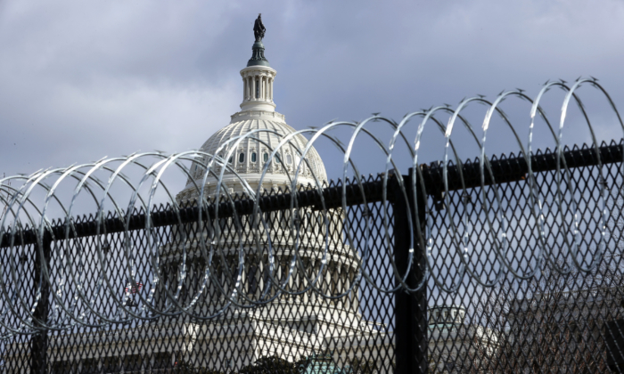An eight-foot tall steel fence topped with concertina razor wire circles the U.S. Capitol  in Washington on Jan. 29, 2021. (Chip Somodevilla/Getty Images)