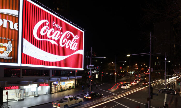 The new Kings Cross Coca-Cola sign is turned on for the first time on September 15, 2016 in Sydney, Australia. (Zak Kaczmarek/Getty Images for Coca-Cola)