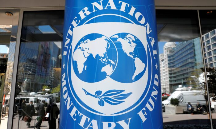 The International Monetary Fund logo outside the headquarters building during the IMF/World Bank spring meeting in Washington on April 20, 2018. (Yuri Gripas/Reuters)
