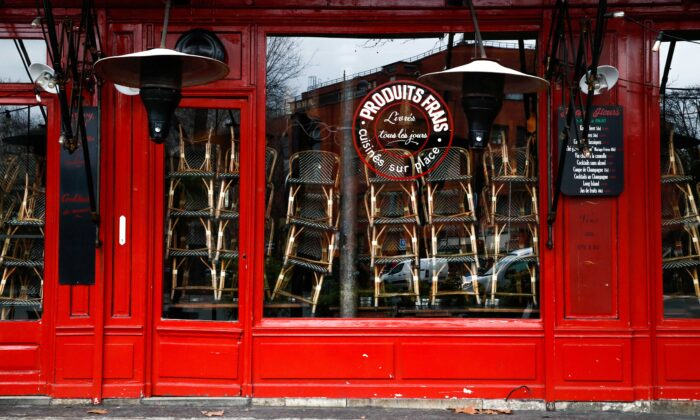 A view shows chairs stacked inside a closed restaurant in Paris as the French government keeps bars and restaurants closed as part of COVID-19 restrictions measures to fight the coronavirus disease outbreak in France, on Jan. 5, 2021. (Gonzalo Fuentes/Reuters)