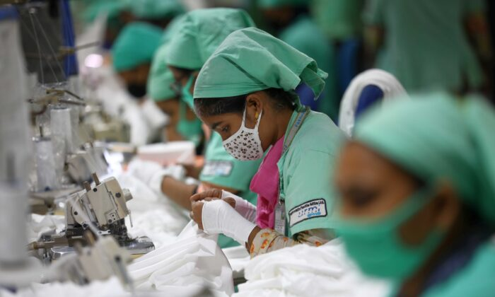 Garment employees work in a sewing section of the Fakhruddin Textile Mills Limited in Gazipur, Bangladesh, on Feb. 7, 2021. (Mohammad Ponir Hossain/Reuters