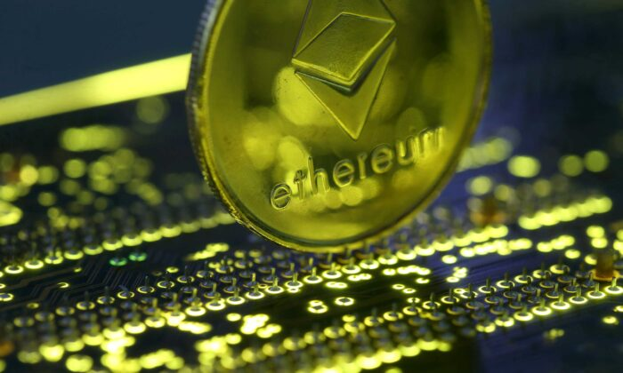 A representation of the Ethereum virtual currency standing on the PC motherboard is seen in this illustration picture on Feb. 3, 2018. (Dado Ruvic/Reuters)