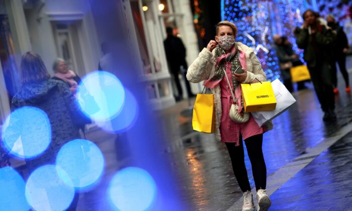 A shopper walks down the street in London, Britain, on Dec. 18, 2020. (Hannah Mckay/Reuters)