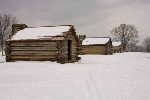 Three,Log,Cabins,At,Valley,Forge,After,A,Snowstorm.