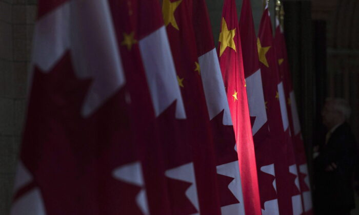 A Chinese flag is illuminated by sunshine in the Hall of Honour on Parliament Hill in Ottawa, Canada, on Sept. 22, 2016. (Adrian Wyld/The Canadian Press)