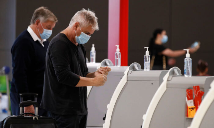 People are seen at Melbourne Airport checking in for flights to New South Wales on Nov. 23, 2020 in Melbourne, Australia. (Daniel Pockett/Getty Images)