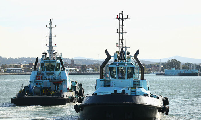 Tugboats return to their base after assisting the 'Toro Orient' through Newcastle Port on July 30, 2015 in Newcastle, Australia. (Cameron Spencer/Getty Images)