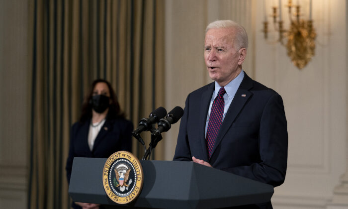 President Joe Biden delivers remarks on the national economy and the need for his administration's proposed $1.9 trillion CCP virus relief legislation with Vice President Kamala Harris in the State Dining Room at the White House in Washington on Feb. 5, 2021. (Stefani Reynolds-Pool/Getty Images)