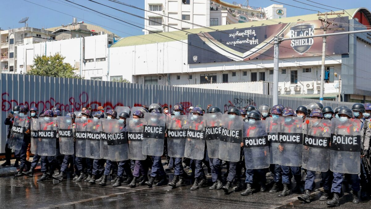 Police in riot gear march