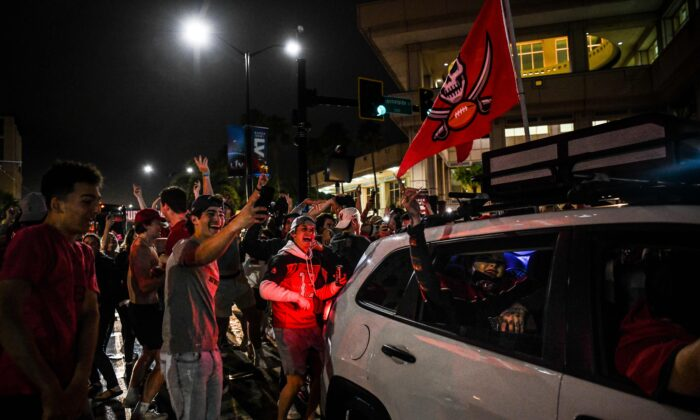 Tampa Bay Buccaneers fans celebrate their victory over the Kansas City Chiefs during Super Bowl LV in a street in downtown Tampa, Fla., on Feb. 7, 2021. (Chandan Khanna/AFP via Getty Images)