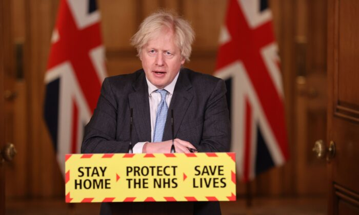 Britain's Prime Minister Boris Johnson speaks during a virtual press conference inside 10 Downing Street in central London, on Feb. 10, 2021. (Steve Reigate/POOL/AFP via Getty Images)