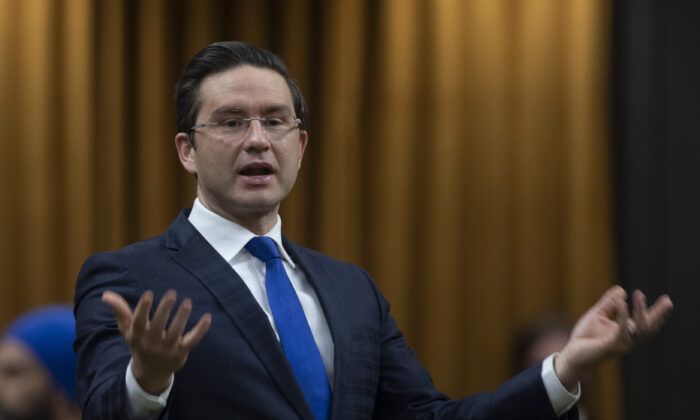 Conservative MP Pierre Poilievre rises during Question Period in the House of Commons in Ottawa, Canada, on Dec. 3, 2020. (Adrian Wyld/The Canadian Press)