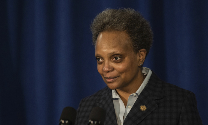 Chicago Mayor Lori Lightfoot demands the Chicago Teachers Union to reach a deal with Chicago Public Schools on a reopening plan during a press conference at City Hall, Chicago, Ill., on Feb. 4, 2021. (Pat Nabong/Chicago Sun-Times via AP)