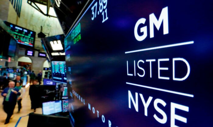 The logo for General Motors appears above a trading post on the floor of the New York Stock Exchange in New York City on April 23, 2018. (Richard Drew/AP Photo)