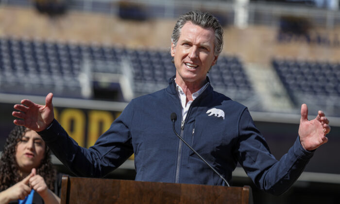 California Governor Gavin Newsom speaks during a press conference at Petco Park in San Diego, Calif., on Feb. 8, 2021. (Sandy Huffaker/AFP via Getty Images)