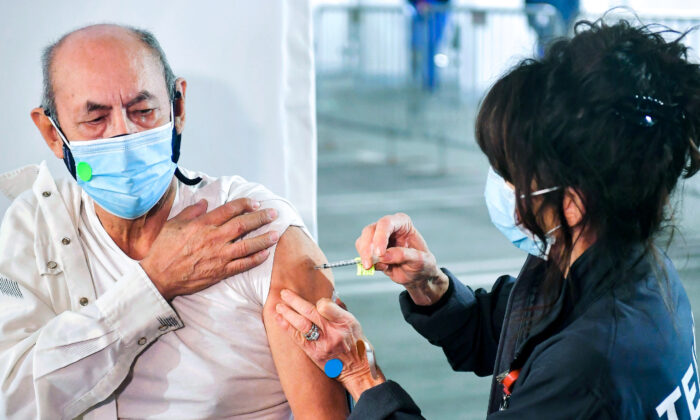 A man receives a COVID-19 vaccine at California State Polytechnic University-Pomona in Pomona, Calif., on Feb. 5, 2021. (Frederic J. Brown/AFP via Getty Images)