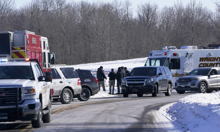 Law enforcement personnel and first responders gather outside of the Allina Health clinic, in Buffalo, Minn., on Feb. 9, 2021. (David Joles/Star Tribune via AP)