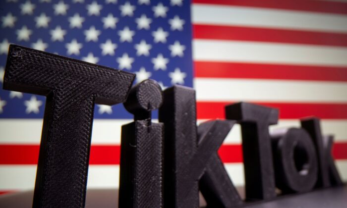 A 3D printed Tik Tok logo is seen in front of a U.S. flag in this illustration taken on Oct. 6, 2020. (Dado Ruvic/Illustration/Reuters File Photo)
