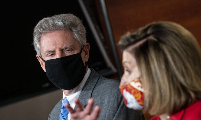 House Energy and Commerce Chairman Frank Pallone (D-N.J.) listens during a press conference as House Speaker Nancy Pelosi (D-Calif.) speaks, in Washington on Nov. 6, 2020. (Al Drago/Getty Images)