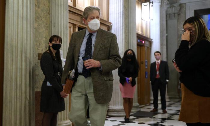 Sen. John Kennedy (R-La.) walks in Washington, on Feb. 8, 2021. (Chip Somodevilla/Getty Images)