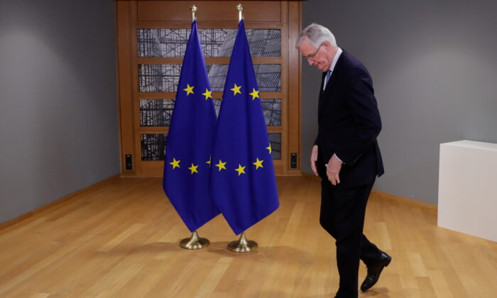 Head of the Task Force for Relations with the UK, Michel Barnier walks ahead of a meeting at the European Council in Brussels, Belgium, on Feb. 9, 2021. (Stephanie Lecocq/Pool via Reuters)