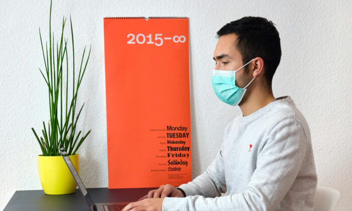 A person works remotely from his laptop during the COVID-19 pandemic, in a file photo (Daniel Foster/Flickr)
