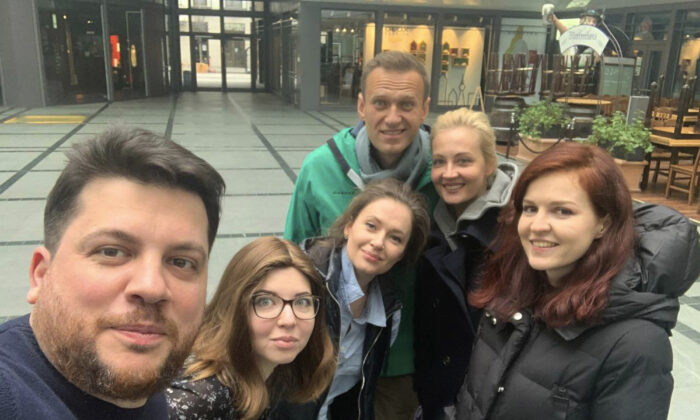 Leonid Volkov (L) poses with Russian opposition activist Alexei Navalny and friends in Germany before returning to Moscow, in a photo posted on Twitter on Jan. 17, 2021.    (Leonid Volkov via AP, File)