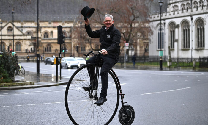 A man rides a penny-farthing bicycle in central London on Jan. 20, 2021. (Daniel Leal-Olivas/AFP via Getty Images)
