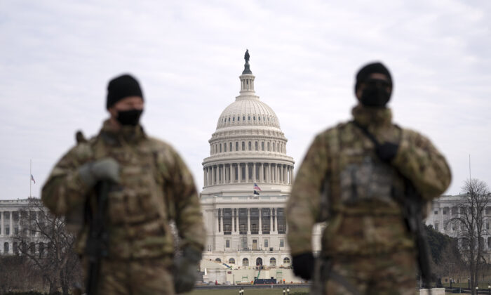 Members of the National Guard patrol the area outside of the U.S. Capitol during the impeachment trial of former President Donald Trump at the Capitol in Washington on Feb. 10, 2021. (Jose Luis Magana/AP Photo)
