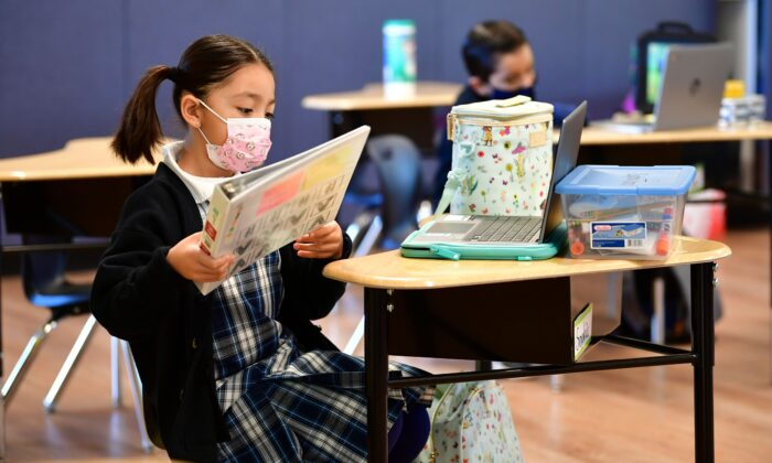First grade students prepare for class at St. Joseph Catholic School in La Puente, Calif., on Nov. 16, 2020. (Frederic J. Brown/AFP via Getty Images)