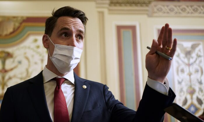 Sen. Josh Hawley (R-Mo.) speaks to reporters during a break in the impeachment trial of former President Donald Trump, at the U.S. Capitol in Washington on Feb. 10, 2021. (Joshua Roberts/Pool/Getty Images)