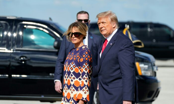 Outgoing President Donald Trump and First Lady Melania arrive at Palm Beach International Airport in West Palm Beach, Fla., on Jan. 20, 2021. (Alex Edelman/AFP via Getty Images)