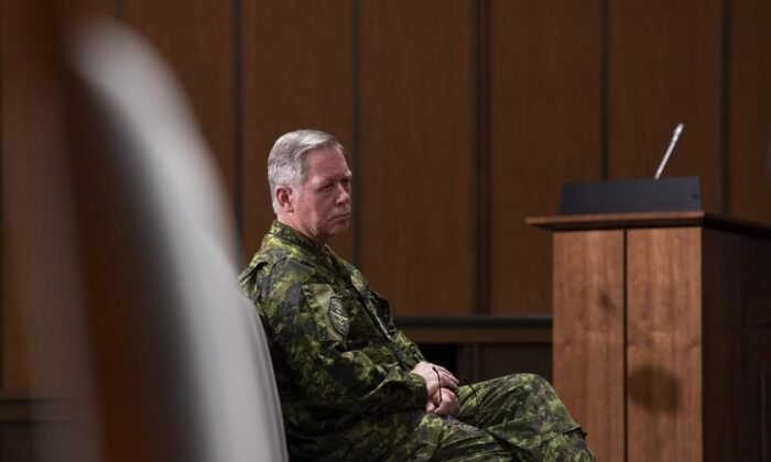 Then chief of defence staff Gen. Jonathan Vance watches a news conference in Ottawa on May 7, 2020. Military police opened an investigation into former defence chief Gen. Jonathan Vance's conduct in 2015, but did not end up laying charges. (Adrian Wyld/The Canadian Press)