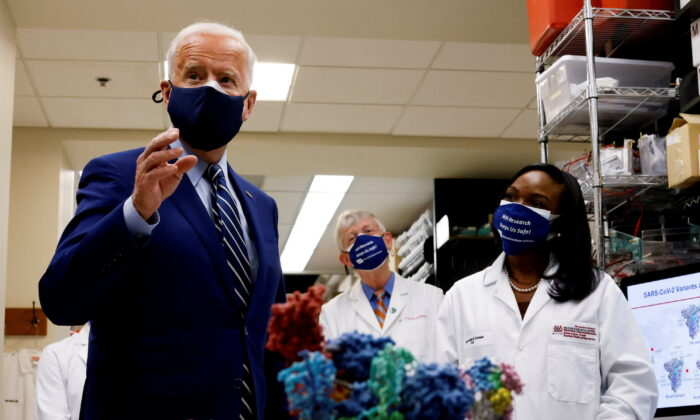 President Joe Biden speaks alongside staff members of the National Institutes of Health (NIH) in Bethesda, Maryland, on Feb. 11, 2021. (Carlos Barria/Reuters)