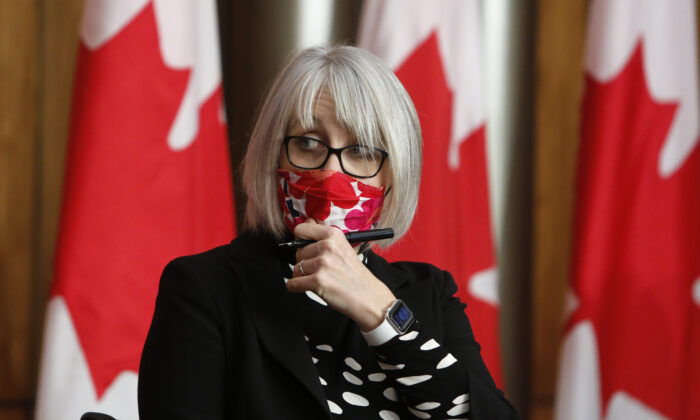 Health Minister Patty Hajdu arrives at a COVID-19 press conference in Ottawa, Canada, on Dec. 11, 2020. (David Kawai/The Canadian Press)