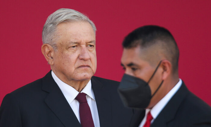 "Mexican President Andres Manuel Lopez Obrador attends the 108th anniversary of the epic military feat known as ""March of Loyalty"", after he faced a coronavirus disease (COVID-19) infection at the Chapultepec Castle in Mexico City, Mexico on Feb. 9, 2021. (Edgard Garrido/File Photo/Reuters)"