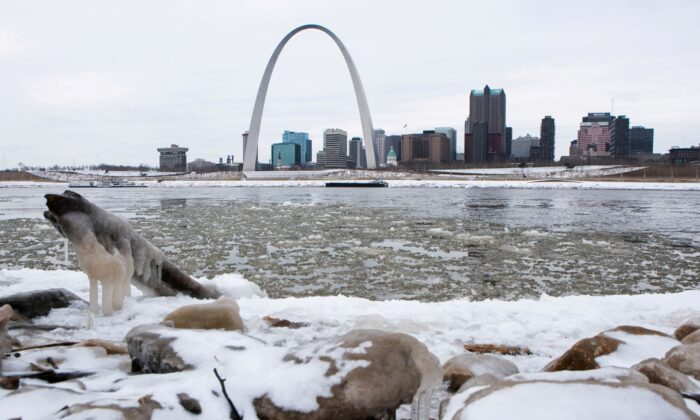 The Gateway Arch is seen across from snow covered banks of the Mississippi River during cold weather in St Louis, Mo., on Feb. 11, 2021. (Lawrence Bryant/Reuters)