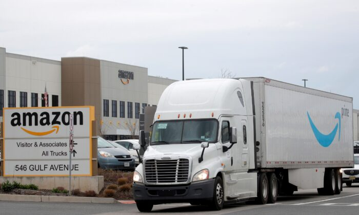 An Amazon truck exits the company's JFK8 distribution center in Staten Island, New York on Nov. 25, 2020. (Brendan McDermid/Reuters)