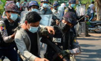 Burmese Police Fire Rubber Bullets, Wounding 3, as Hundreds of Thousands Protest