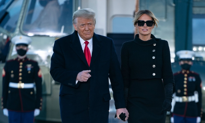 President Donald Trump and First Lady Melania Trump step out of Marine One at Joint Base Andrews in Maryland on Jan. 20, 2021. (Alex Edelman/AFP via Getty Images)
