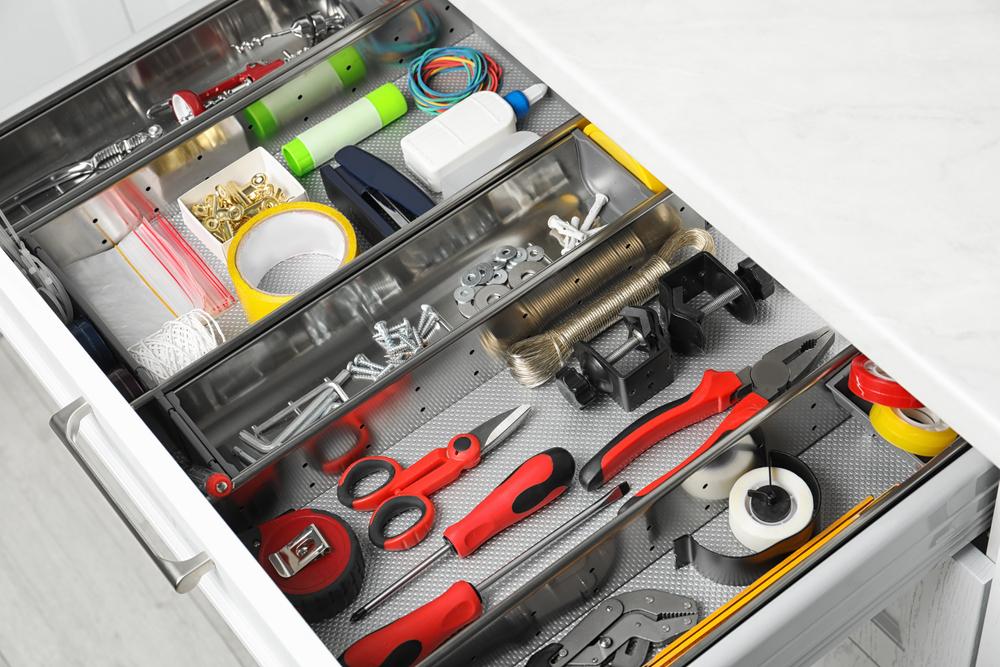 Set,Of,Instruments,In,Open,Desk,Drawer,Indoors