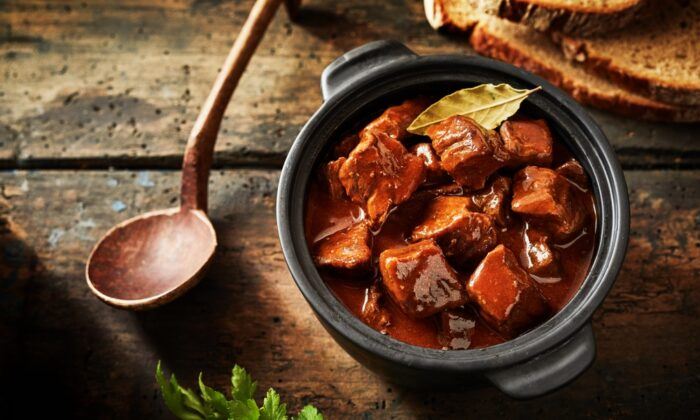 Hungarian goulash may have as many variations as there are home cooks, but generally involves chunks of beef simmered until tender, with a generous helping of sweet paprika. (stockcreations/Shutterstock)