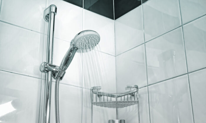 Always rinse off the shower walls after bathing. (Protasov AN/Shutterstock)
