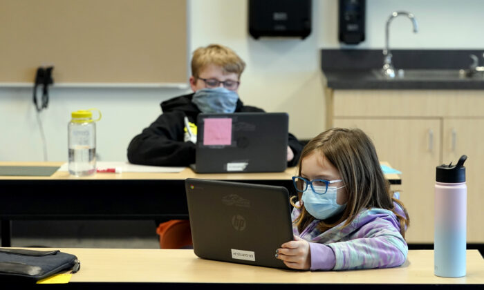 Students wear masks as they work in a fourth-grade classroom, at Elk Ridge Elementary School in Buckley, Wash., on Feb. 2, 2021. (Ted S. Warren/AP Photo)