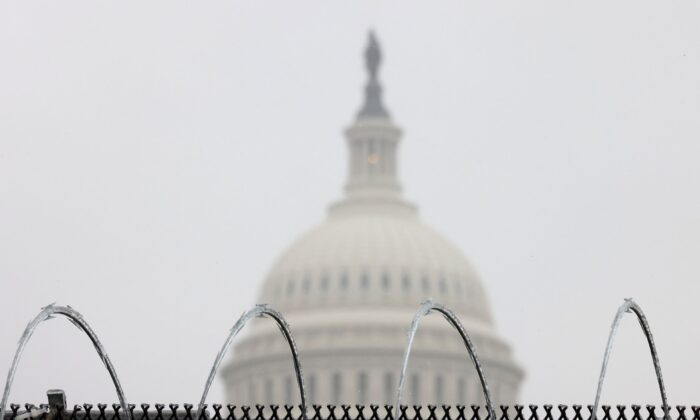 Razor wire is shown atop a fence outside the Capitol in Washington during the fifth day of former President Donald Trump's impeachment trial on Feb. 13, 2021. (Win McNamee/Getty Images)