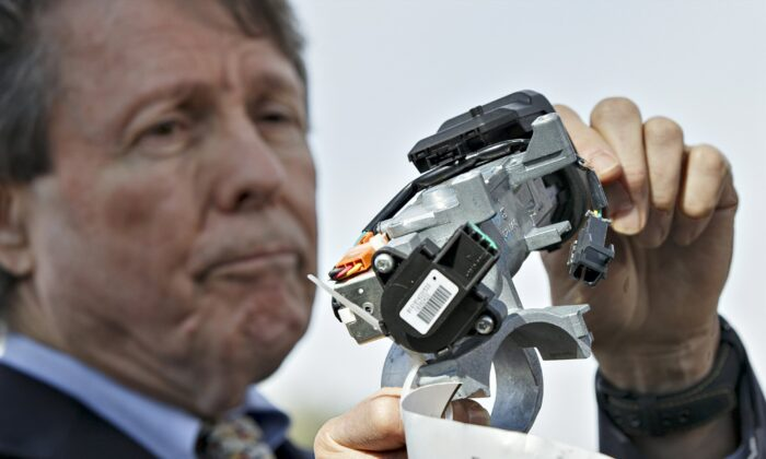 Clarence Ditlow, executive director of the Center for Auto Safety, displays a GM ignition switch similar to those linked to 13 deaths and dozens of crashes of General Motors small cars like the Chevy Cobalt, during a news conference on Capitol Hill in Washington on April 1, 2014. (J. Scott Applewhite/AP Photo)