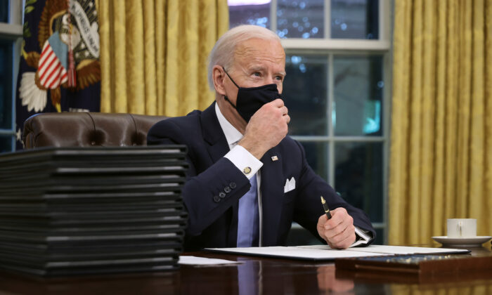 President Joe Biden prepares to sign a series of executive orders at the White House, just hours after his inauguration on Jan. 20, 2021. (Chip Somodevilla/Getty Images)